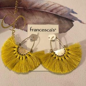 Yellow fan earrings.